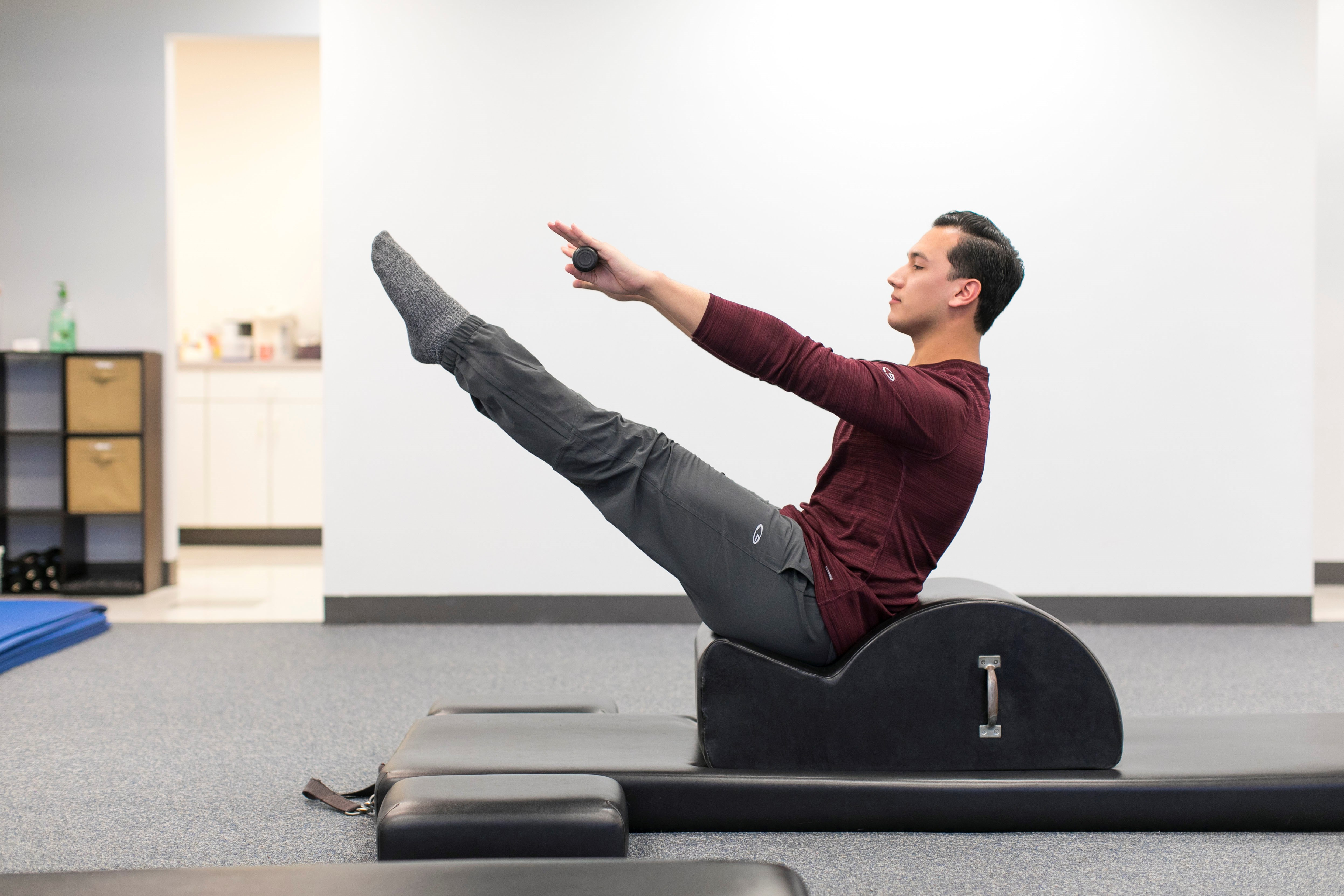 Student in seated v position in Pilates class