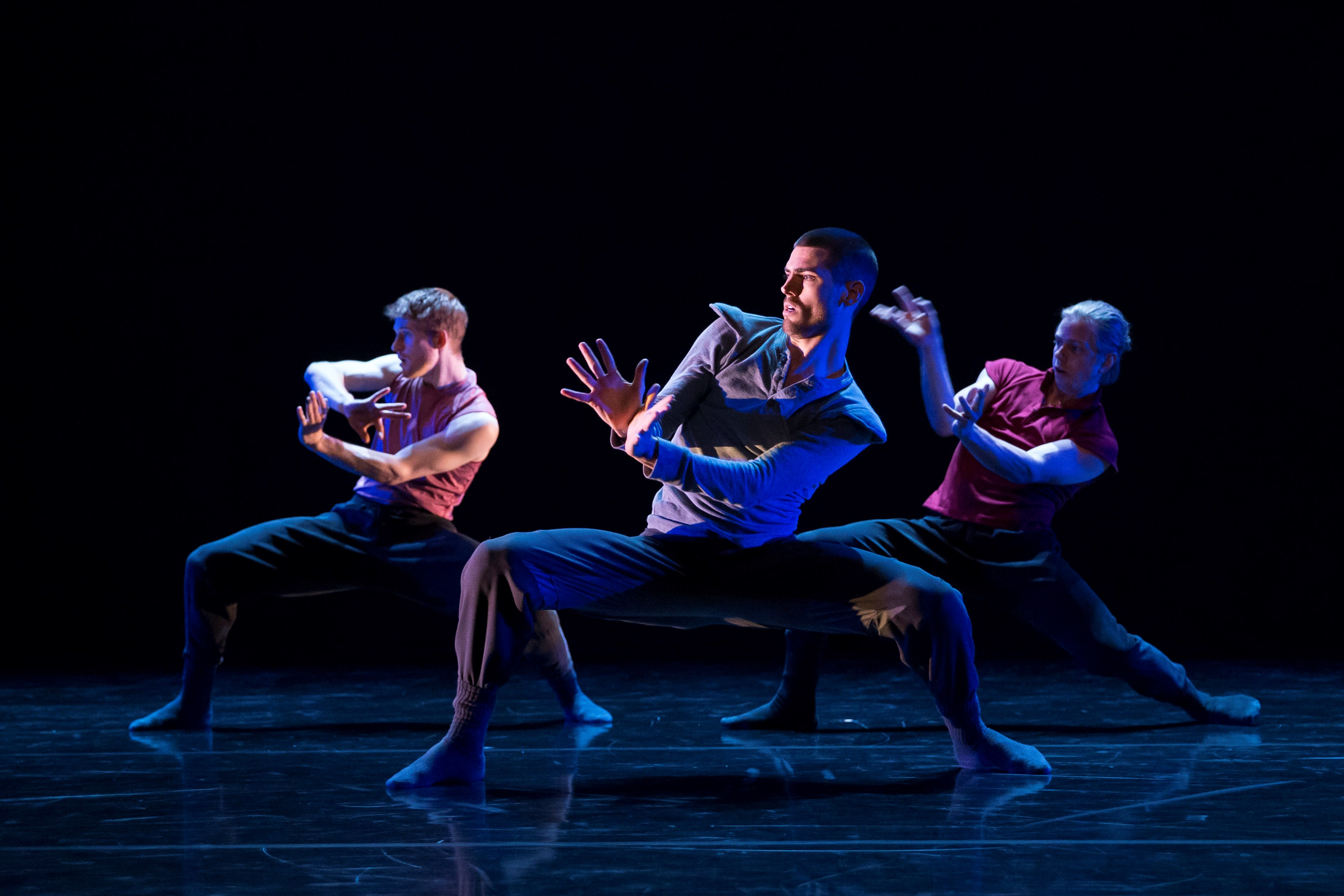 Hubbard Street Dancer's Michael Gross, David Schultz, and Elliot Hammans in Clan(device) by Alice Klock. Photo by Todd Rosenberg.